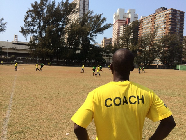 Thulani coaching a community female football team